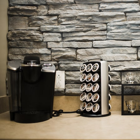 A coffee machine and coffee refill pods in front of a brick wall